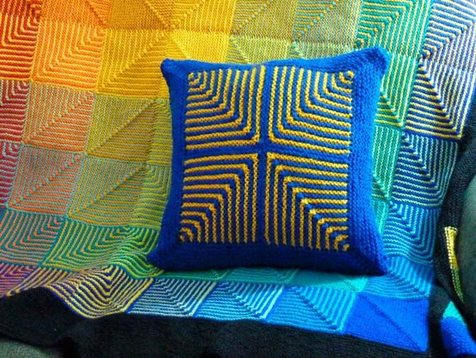 Afghan Scraps Cushion Tops designed with leftovers by Cynthia MacDougall for ANTmag Spring 2017 Issue. After 3 years, I finally completed an afghan that was made in 'crayon colours'. When it came to the outside border, I added more yarn for the border so I could make better use of the fabulous center colours by incorporating a customized colour-block design. When I still had yarn scraps in all of the colours left, I wanted to keep going. So, I created these crayon-coloured cushion tops.