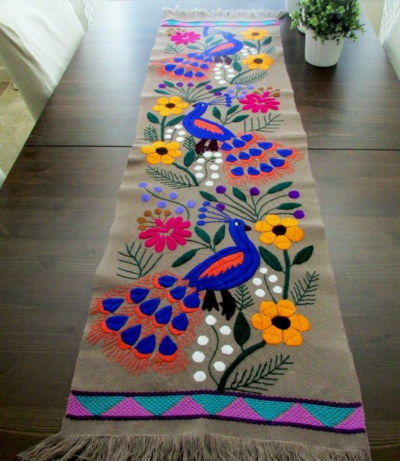 Table runner beautiful color gray as main color, Mexican Textile, it has embroidered Peacock in blue and orange, hummingbirds, other birds and