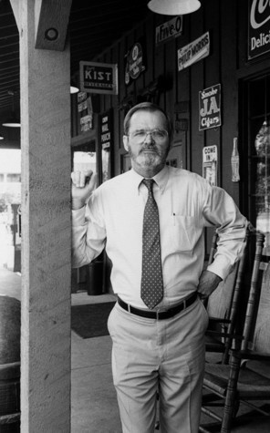 Dan W. Evins, the founder of Cracker Barrel Old Country Store, died Jan. 14 in Lebanon, Tenn. He was 76. In this image he is shown standing on the front porch of one of his stores.