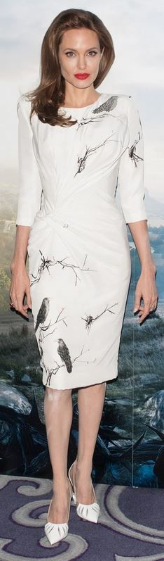Who made Angelina Jolies white long sleeve bird print dress and white pumps that she wore in London on May 9, 2014?
