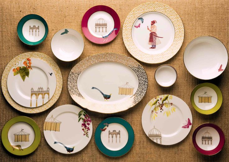 BARADARI DINNER SERVICE Inspired by the outdoor gardens that the Mughals so loved and used for recreation and entertainment. Their garden pavilions with twelve arched doors were called Baradari. Goodearth's Baradari Set makes a strong statement as a dramatic and original table setting. #HandDecorated and painted on #FineBoneChina. Shop the collection on our #WebBoutique . #EntertainInStyle #BridalWishList