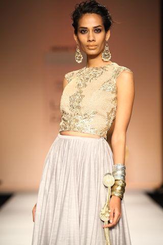 Dusk grey tulle choli with gold jaali work worn with silk mul lehnga with banarsi cotton silk border. SHOP THE LOOK: http://www.payalsinghal.com/off-the-runway/mumtaz-lehnga
