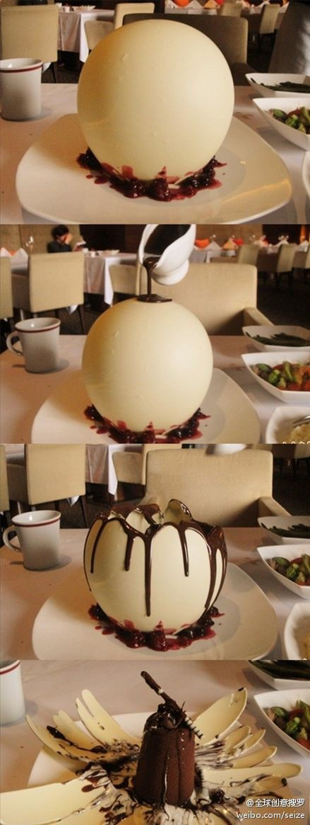 This is some presentation! As you pour hot fudge over white chocolate it cracks the outer shell and reveals a chocolate cake inside! This dessert was served in an upscale restaurant in Beijing.