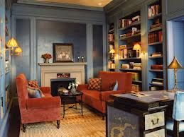 A soft greyed blue is coupled with rusty tones for a beautiful traditional look in this small sitting area.