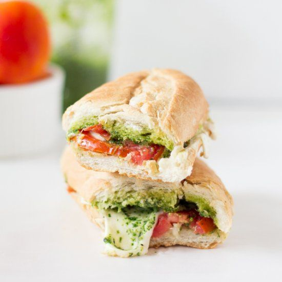 This Caprese Sandwich takes a twist by being toasted with melted mozzarella, and creamy parsley pesto. Perfect for an everyday lunch!