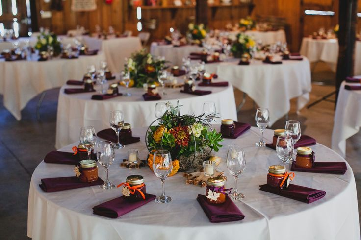 Pumpkin center pieces filled with fall foliage and plum napkins with jam favors