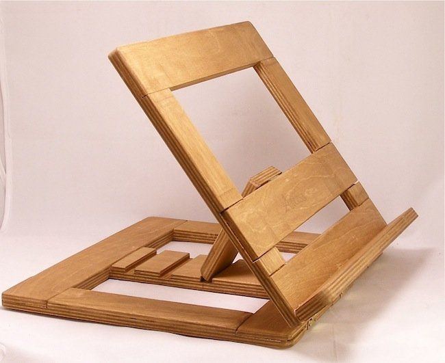 The wooden book stand design has a diagonal framework hold ...