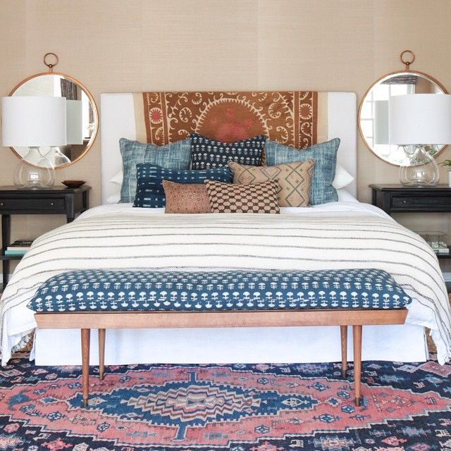 Eclectic master bedroom with mix and match patterns. And mirrors