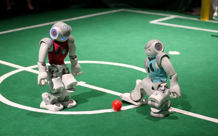 Robots from the University of Miami, College of Arts and Sciences' Department of Computer Science play a game of football at the eMerge Americas Techweek held in Miami.