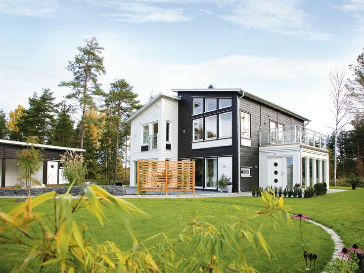 Grönskär, ett hus i funkisstil som passar smala tomter. Många fönster och en öppen planlösning.