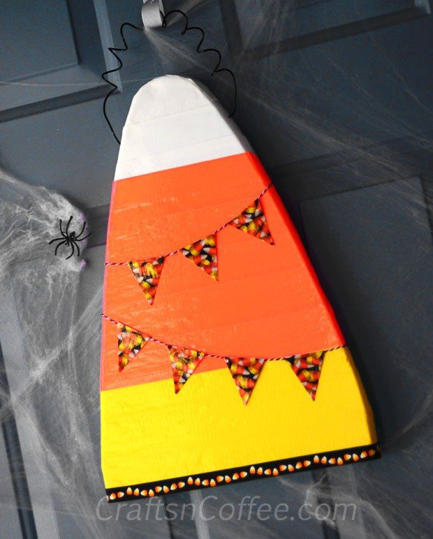 If you love candy corn (and super-fast crafts), make this Duct Tape Candy Corn Door Hanger. Tutorial on CraftsnCoffee.com.