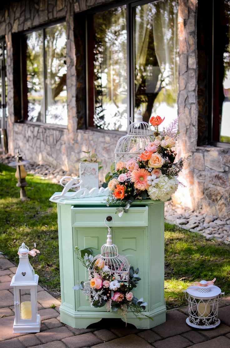 Wedding decor in cages and minth furniture.