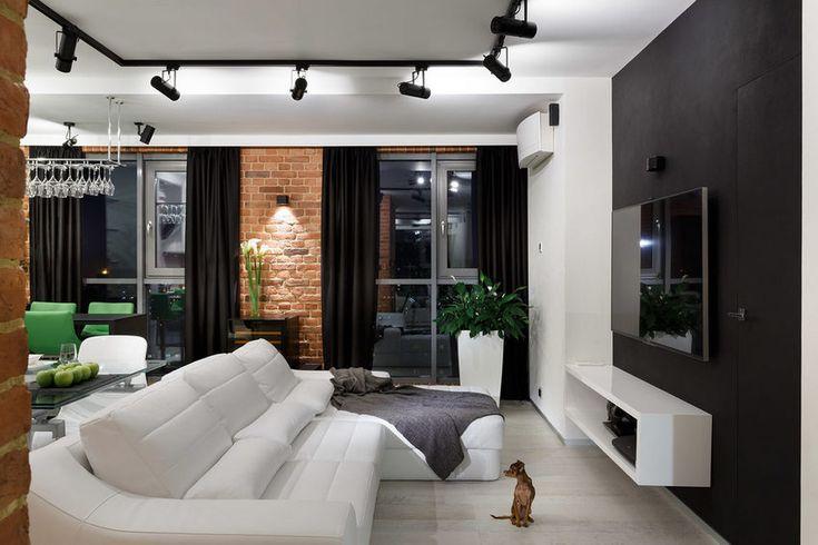 Fiatal pár új, 76 négyzetméteres, két és fél szobás lakását tervezte meg a lakberendező belsőépítész, a megrendelők igényei szerint a modern lakótér berendezését, dekorációját markáns, kontrasztos elemekkel alkotta meg, ipari stílusban.