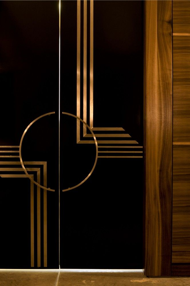 Beautiful Art Deco inspired detailed doors with circular pulls                                                                                                                                                                                 More