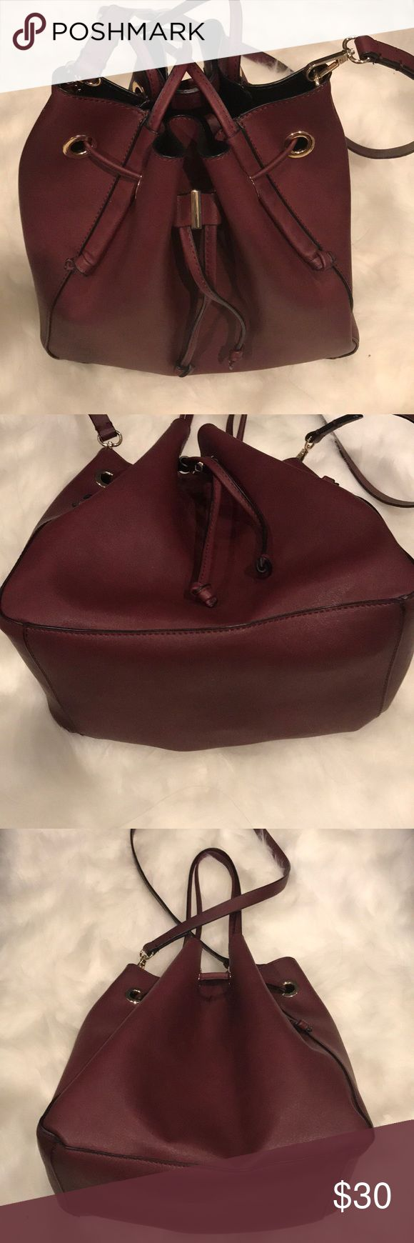 Zara handbag Zara handbag with handle and shoulder straps.  This can be worn as a tote or messenger bucket bag.  Color is wine/burgundy.  In excellent like new condition, this bag was barely worn.  No stains or tears. Zara Bags