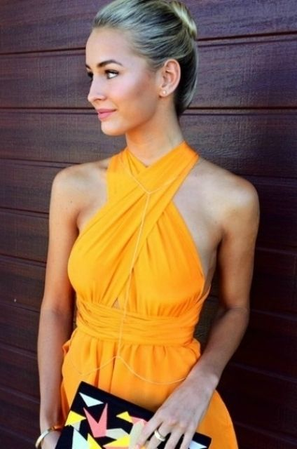 Tanned blonde fashion instagram blogger and model  wearing pure silk mini Multiway Playsuit by Sisters The Label in tangerine dream - orange yellow Flowy high or Plunging neckline Party pure silk Playsuit dress / romper / jumpsuit