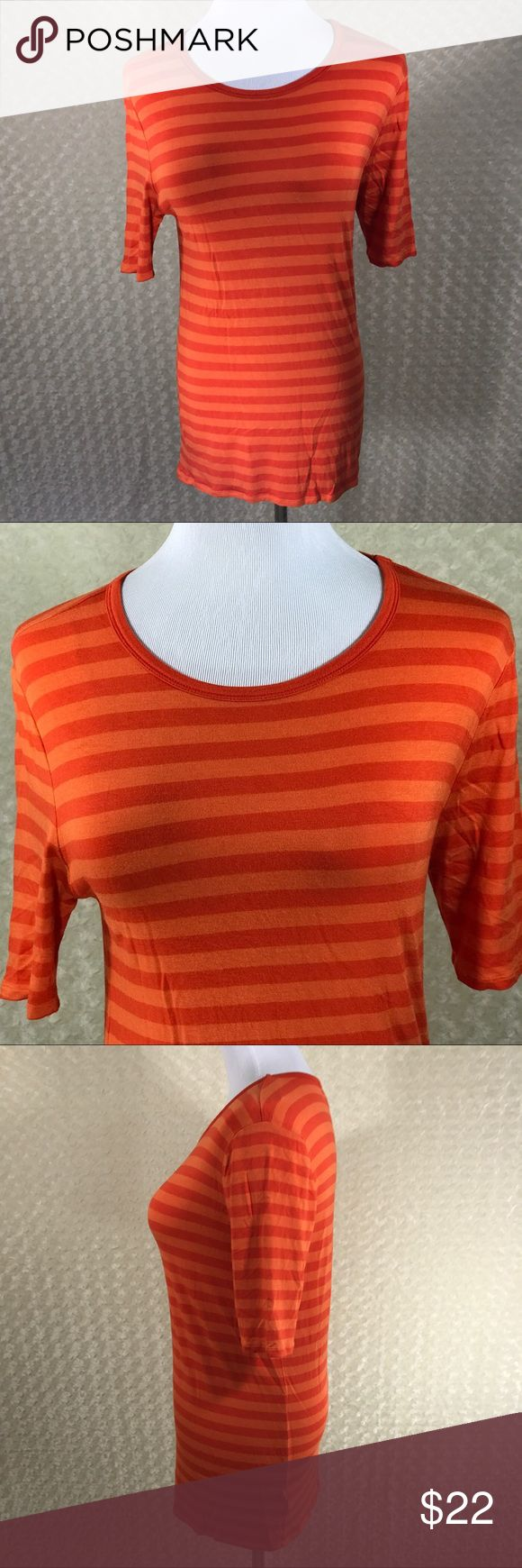 "Michael Kors Size M Red Orange Striped Top Michael Kors Size M Red and Orange Striped Short Sleeve Top  This item is gently used with no flaws. — see pictures for details Armpit to Armpit - 18"" Length from back of neck to Bottom - 26"" Sleeve Length - short sleeve Made in China Material is 95% Rayon, 5% Spandex  Inventory - E535 Michael Kors Tops Blouses"