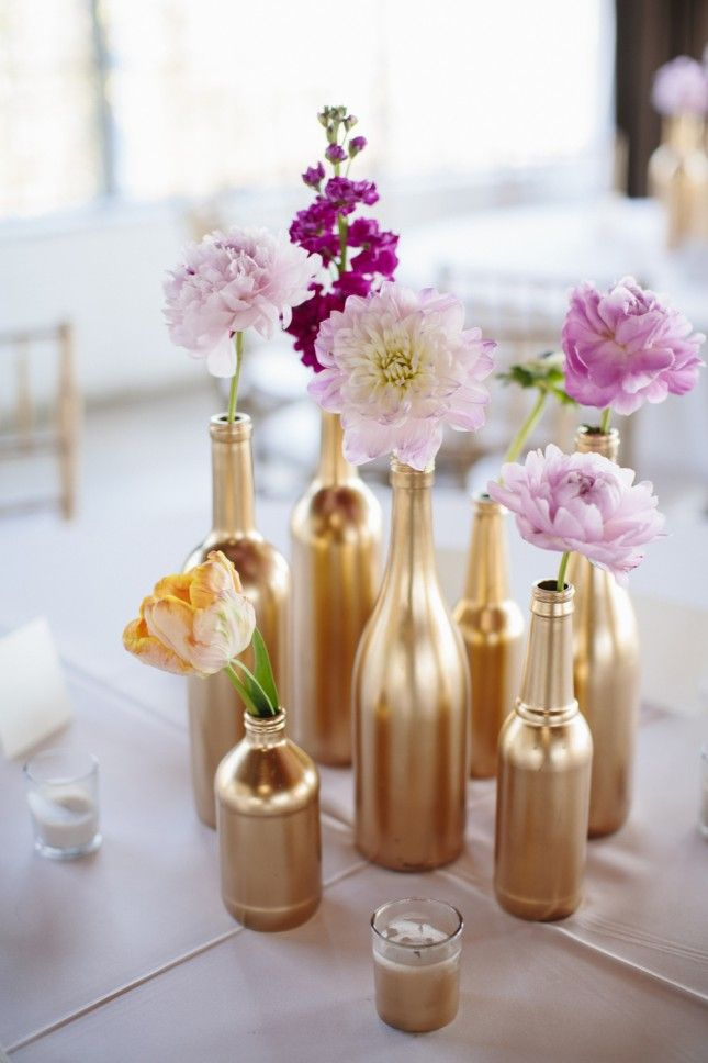 You can't go wrong with gold-painted wine bottles as single-stem vases.