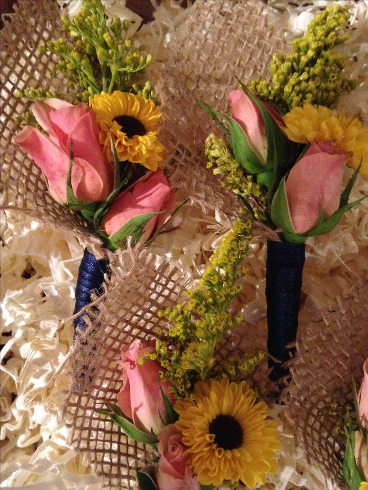 Burlap wrapped, mixed flower, boutonnières are very trendy this season!