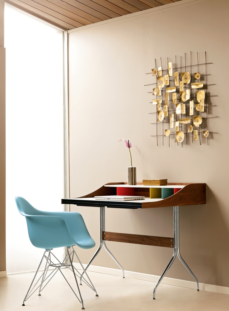 Wall art. Nelson Swag Leg Desk | Designed by George Nelson. Chair by #Eames.