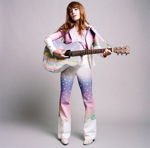 """Jenny Lewis's """"magical rainbow suit,"""" airbrushing by Adam Siegel onto a vintage white suit."""