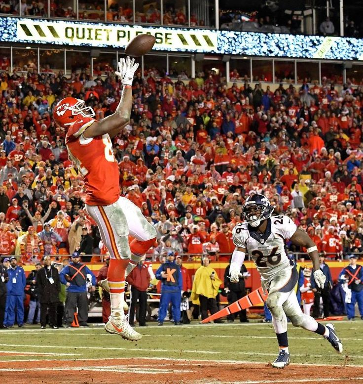 Kansas City Chiefs tight end Demetrius Harris catch a touchdown pass from nose tackle Dontari Poe in the fourth quarter in front of Denver Broncos free safety Darian Stewart during Sunday's football game at Arrowhead Stadium in Kansas City, Mo.