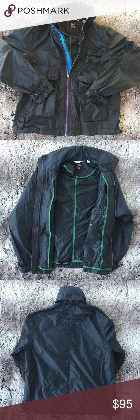 """Paul Smith Men's Raincoat Nice and Thin this Hooded Nylon 6 Pocket rain jacket is great! Black with purple /green accents. Hideaway Hood. Measurements: Top to Bottom 27"""" Sleeves 26.5"""" Shoulder to Shoulder 19"""" Like New. Great Condition. Paul Smith Jackets & Coats Raincoats"""