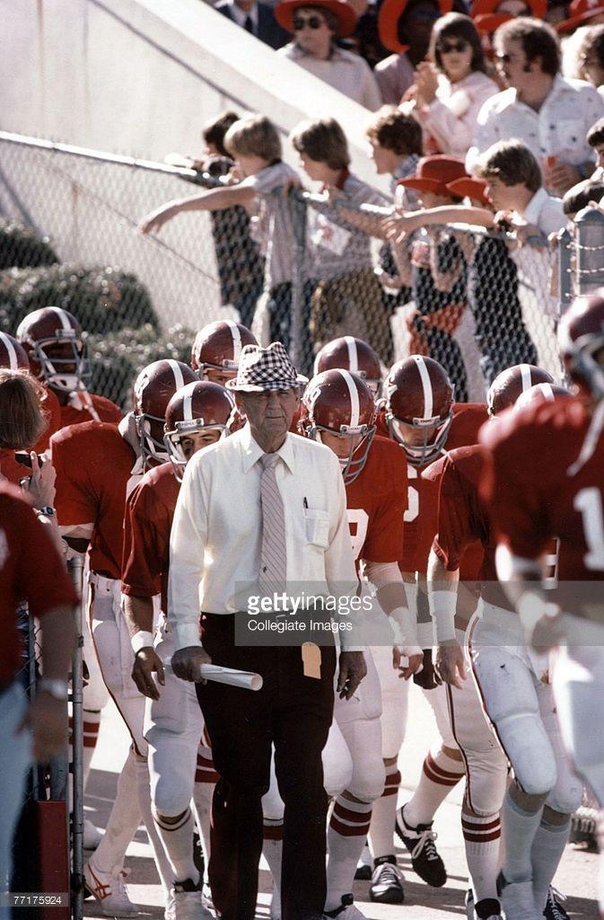 Paul 'Bear' Bryant of the University of Alabama Crimson Tide walks out onto the field in Tuscaloosa, Alabama.