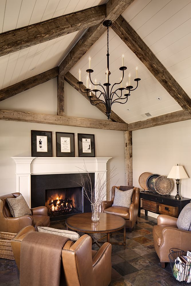Remodeled greeting room with reclaimed barn beams, a slate floor, large chandelier, and tongue and groove ceiling