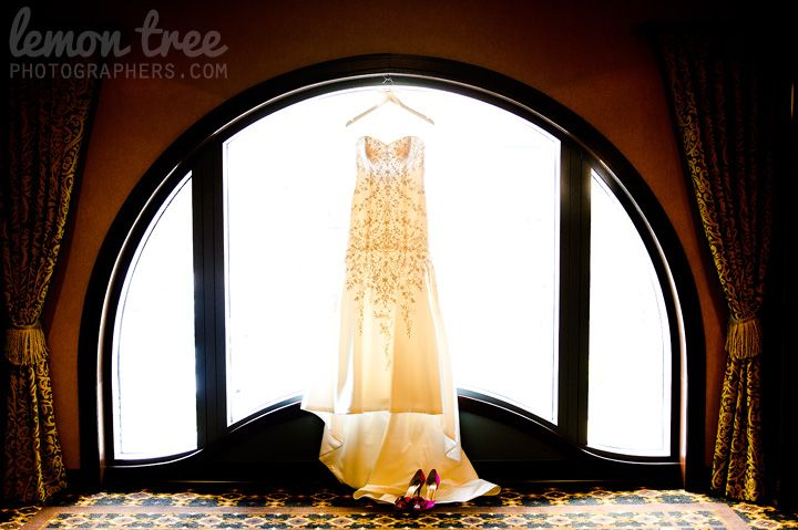 Wedding dress at the Hotel Julien Dubuque by Madison Wedding Photographers at http://www.LemonTreePhotographers.com