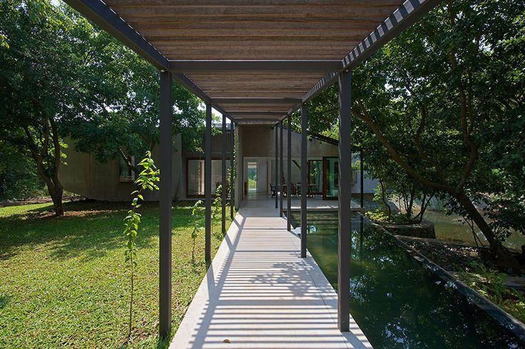 House on a Stream, Alibag - Architecture BRIO Pool Verandah #pergola #sustainablearchitecture #infinitypool