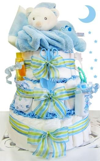 Shhh! Baby bear is ready for his nap! This adorable diaper cake features a plush bear perfect for cuddle time. Also included is a super soft travel blanket tha