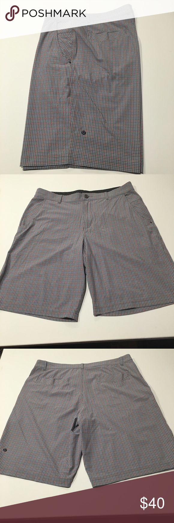 Lululemon men's shorts Gray shorts with red and blue plaid.  Euc.  Zipper and snap.  Fits like 36 lululemon athletica Shorts
