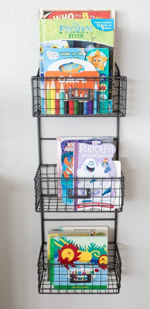 A great way to store children's books in the living room! farmhouse modern living room // modern white living room ideas // living room decor ideas // modern living room ideas // family// kid's book storage ideas // living room // open space living room
