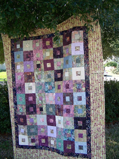 batik quilt top by Realisa on Flickr                                                                                                                                                                                 More
