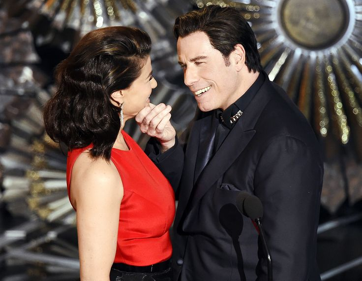 "John Travolta and Idina Menzel reunited one year after the ""Adele Dazeem"" meme went viral at the 2015 Oscars -- watch the bonkers moment now!"