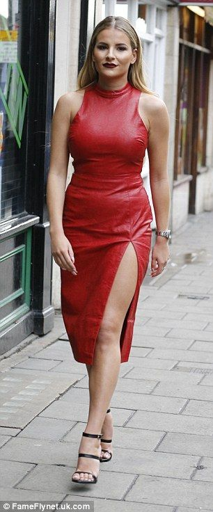 Two of a kind:Turning heads in a scarlet latex dress, Georgia Kousoulou, 25, oozed glamou...