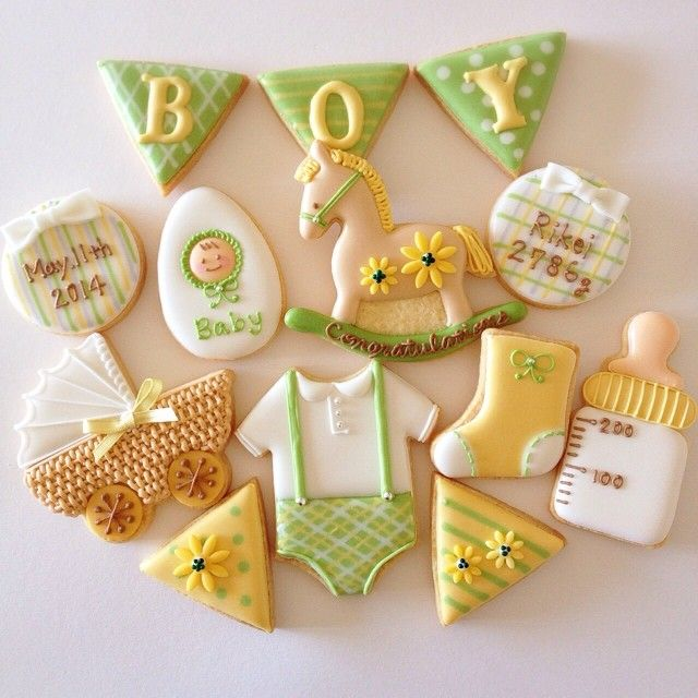 Baby cookie set - rattle, rocking horse, bottle, and more. Green & yellow theme.