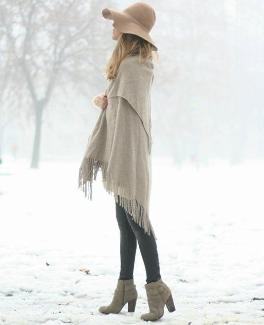 This girl gets points for wearing a shawl that serves the same function as a flowy tunic and heels that elongate what is visible of her legs.