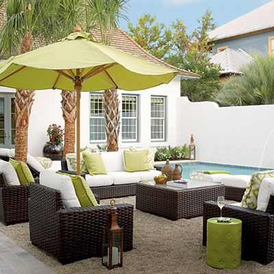 These lime accessories pep up the deeper shades of the plantings. | Coastalliving.com