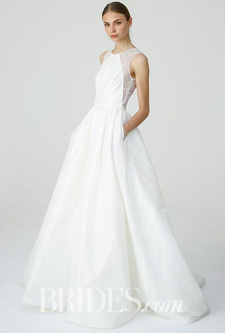 "Brides.com: . ""Jodie"" illusion lace cutaway shoulder and ballgown skirt with pockets, Nouvelle Amsale"