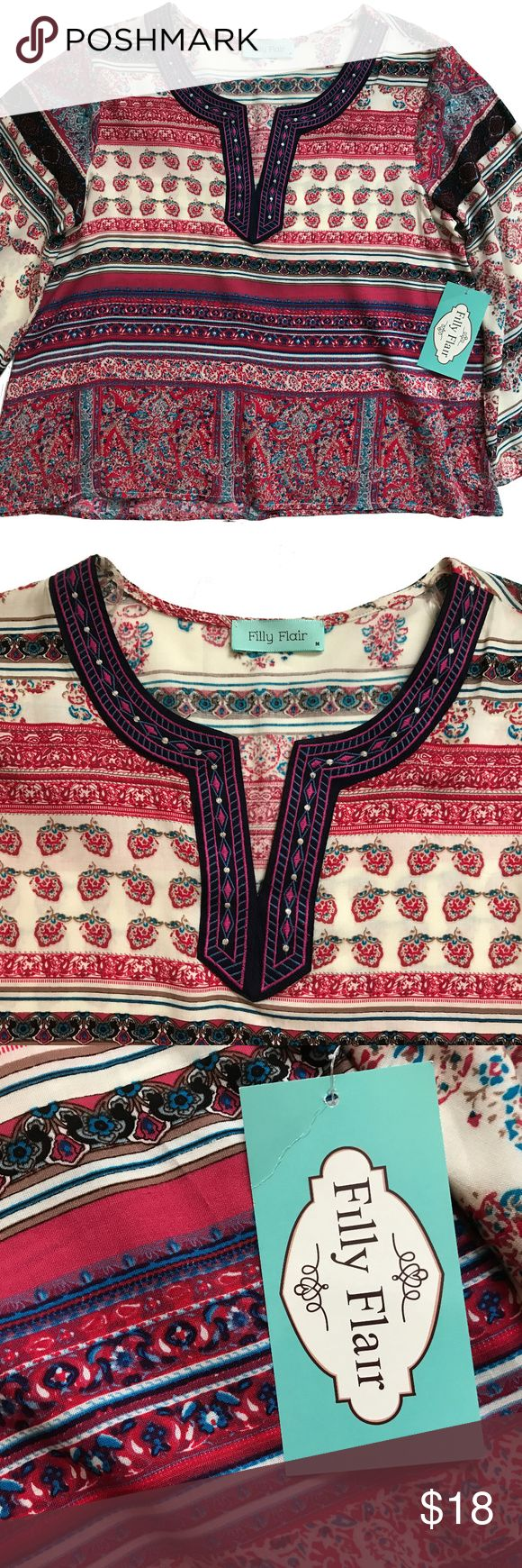 Tribal Boho Bell-Sleeve Filly Flair Medium This is a wonderful bohemian-style 3/4-length bell-sleeve top made of 100% viscose, so it's nice, light, and airy. Embroidered v-neck front. Filly Flair Tops Blouses