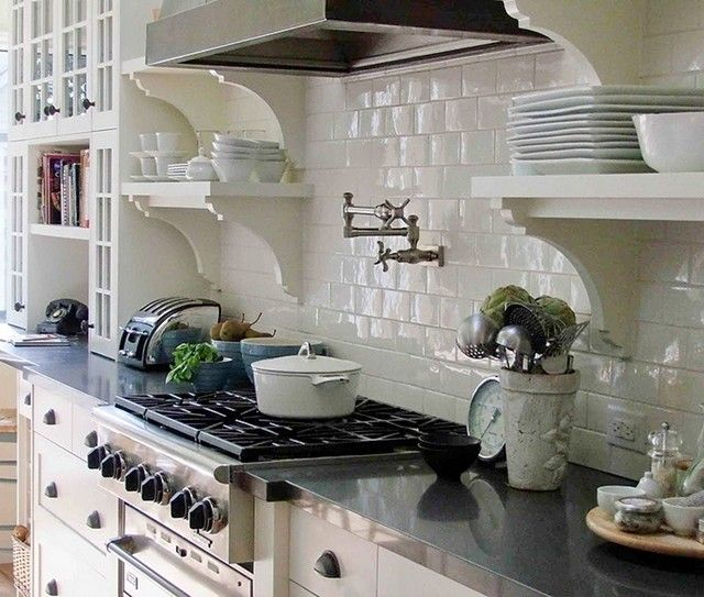 White kitchens, stainless steel appliances, potfiller and subway tile.  Love it all - classic.