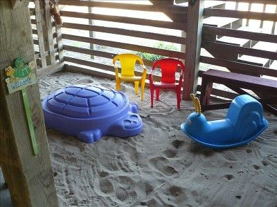 Kids of all ages LOVE the special sand play area under front deck!