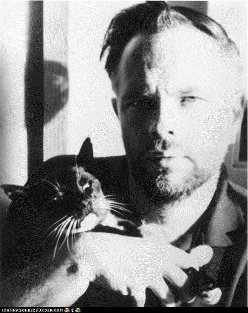 Philip K. Dick with a cat. Do flesh-and-blood cats dream of flesh-and-blood mice? You bet they do!