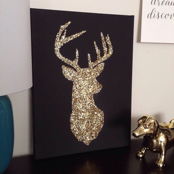 This gold glitter deer silhouette on black canvas makes an eye-catching statement. Easy to hang on a wall or display on a desktop. Canvas