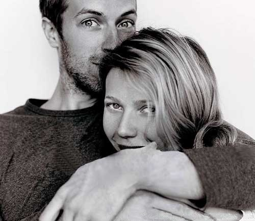 Singer Chris Martin and Actress Gwyneth Paltrow.  Christopher Anthony John Martin. Born 2 Mar 1977, Exeter, Devon, England.  Gwyneth Kate Paltrow. Born 27 Sept 1972, Los Angeles, California