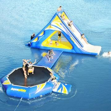 Inflatable water slide with trampoline, for water park sports game  For jetties, dry docks and pontoons - contact DOCKPRO for modular flotation systems. info@dockpro.co.za | www.dockpro.co.za