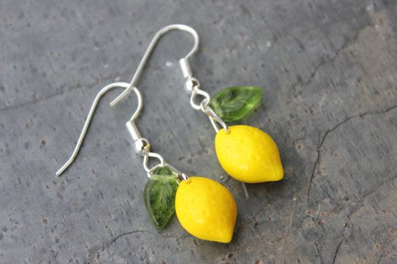 These earrings feature adorable little bright yellow glass lemon beads and tiny translucent green glass leaves on silver plated surgical steel hypoallergenic ear wires.  The earrings are 1.5 long, and the lemons themselves are 1/2 long.  I have a matching necklace available, buy the set and save $$$ (see last photo). I also have a matching bracelet. To view these listings, click link below:  http://www.etsy.com/shop/cuteandfun/search?search_query=lemon+grove...