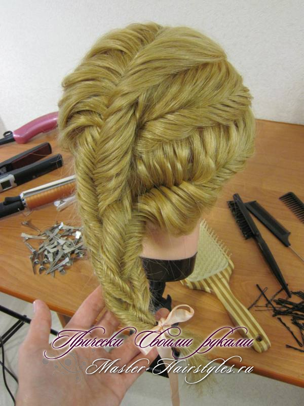 "Another way to style the three-fish braid!  Make two diagonal parts through your hair, and style each section into a ""French"" fishtail braid, then braid the tails together to finish."